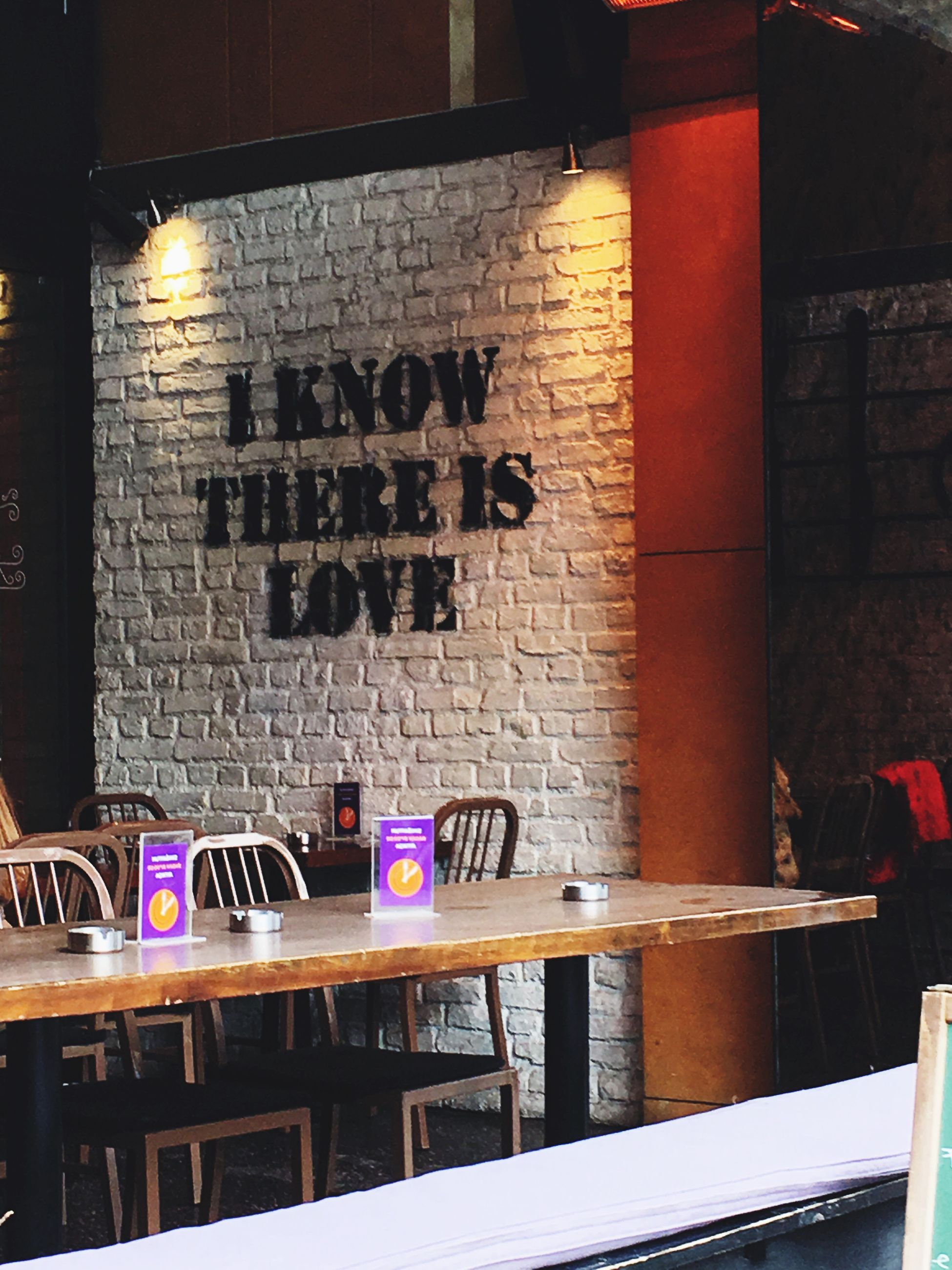 text, communication, brick wall, bar - drink establishment, no people, city, architecture, indoors, day