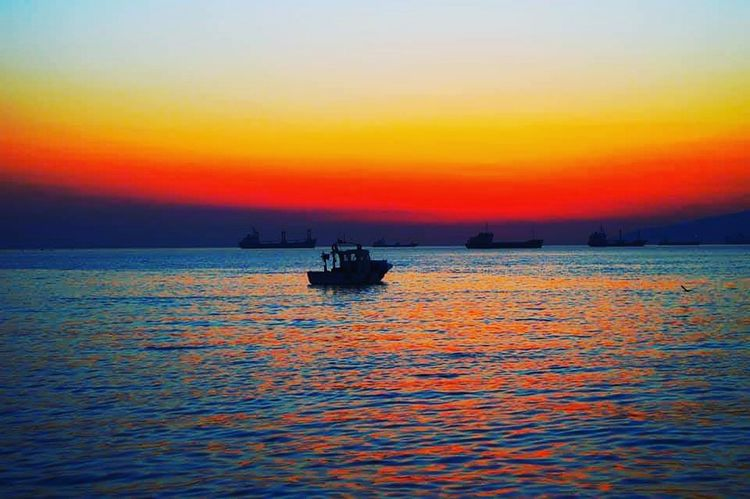 gemlik türkiye EyeEm Best Shots EyeEm Nature Lover Kumla Gemlik Türknikon Benimkadrajim Sky And Clouds Sunset #sun #clouds #skylovers #sky #nature #beautifulinnature #naturalbeauty #photography #landscape Sunset Multi Colored Water Sky Landscape Scenics Nature Beach Beauty In Nature Nautical Vessel Sun Travel Destinations Vacations Floating On Water