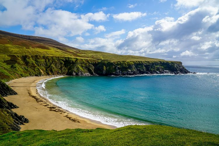A stunning crescent shaped beach on the northern coast of Ireland. Atlantic Coastline Ireland Perspectives On Nature Beach Beauty In Nature Cloud - Sky Day Grass Horizon Over Water Landscape Nature No People Ocean Outdoors Sand Scenics Sea Seascape Sky Tranquil Scene Tranquility Tree Water