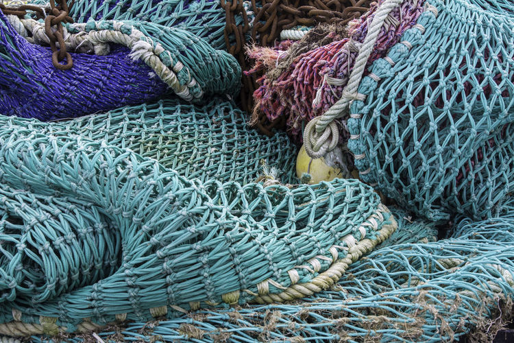 High Angle View Of Fishing Net At Harbor