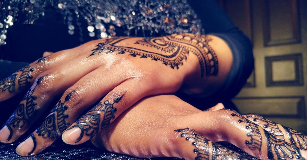 Close-Up Of Mehendi Pattern On Hands