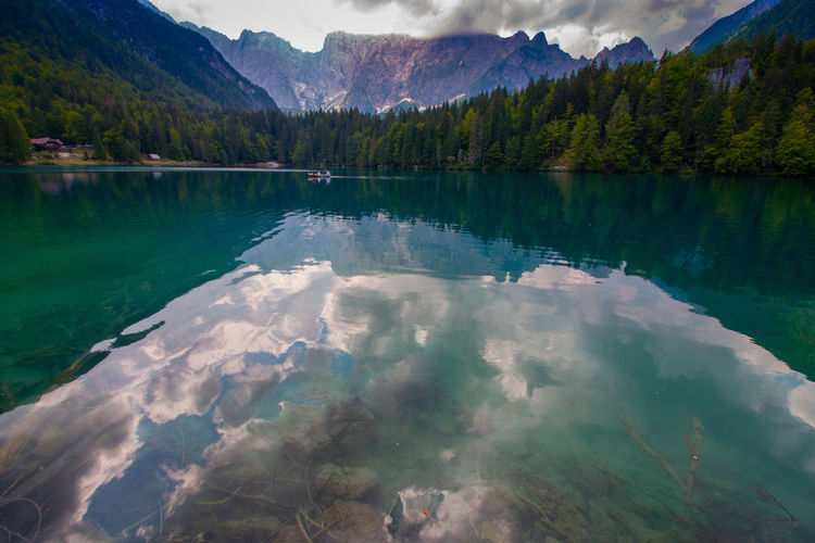 peaceful lago di fusine in front of mount mangart EyeEm Best Shots EyeEm Nature Lover EyeEmNewHere Beauty In Nature Day Idyllic Italy Lago Di Fusine Lake Mountain Mountain Range Nature No People Non-urban Scene Outdoors Plant Reflection Scenics - Nature Sky Tranquil Scene Tranquility Tree Turquoise Colored Water Waterfront