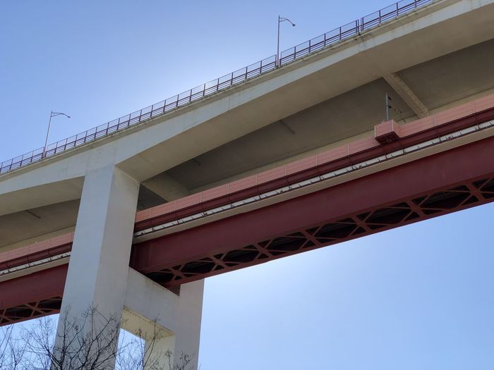 Low angle view of road bridge against clear blue sky in Lisbon, Portugal Lisbon Portugal Built Structure Architecture Sky Low Angle View Clear Sky Bridge Bridge - Man Made Structure Nature Day No People Connection Blue Transportation Architectural Column Building Exterior Outdoors City Overpass Railway Bridge Rail Transportation Multiple Lane Highway