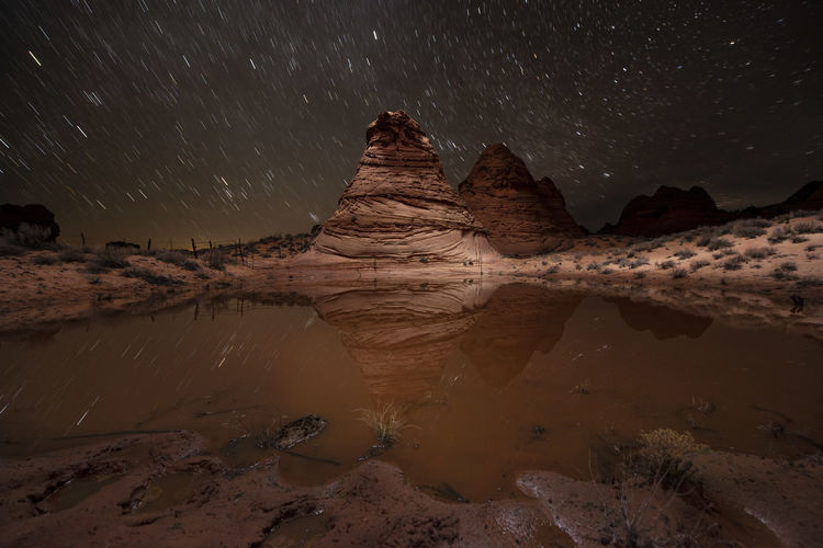 Scenic view of rocks at night against sky