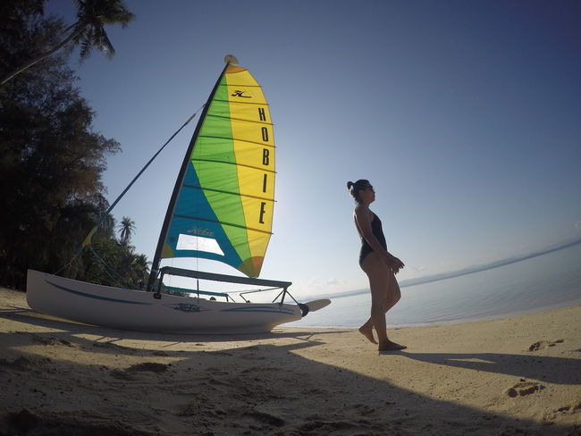 Beach Clear Sky Full Length Land Leisure Activity Lifestyles Men Mode Of Transportation Nature Nautical Vessel One Person Outdoors Real People Sailboat Sand Sea Sky Standing Transportation Water