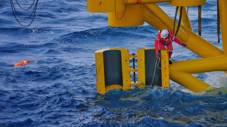 Worker on nautical vessel in sea