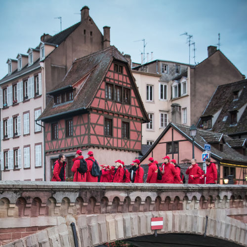 Alsace Petite France Streetphotography Day Half Timbered Half Timbered House Architecture Built Structure Building Exterior Building Nature Sky Residential District City Outdoors Old City Red Group Of People The Past History Connection Bridge Red Color Old House Colors Bridge - Man Made Structure