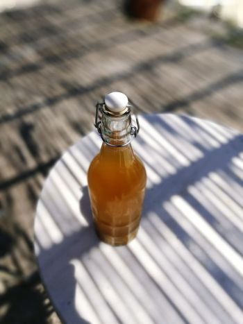 Shadow Bottle Table Sunlight High Angle View Outdoors Day No People Close-up Freshness Waterkefir Kefir Dring Homemade Probioticdrink Probiotic