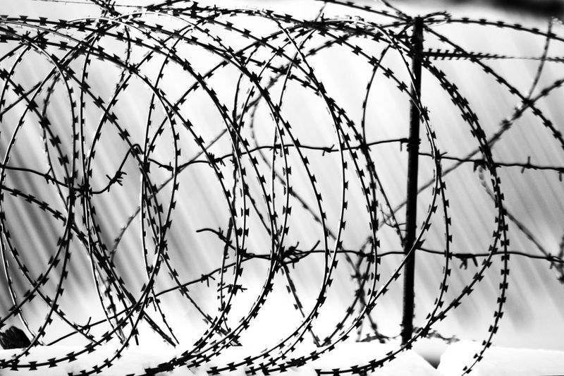 Jail Russia Backgrounds Barbed Wire Close-up Comunication Day Metal No People Outdoors Pattern Prison Problem Protection Razor Wire Sad Safety Security Sick Sky Spiral Wire