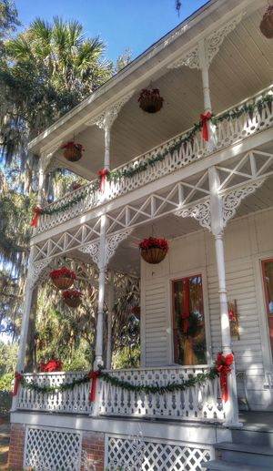 Baker house in wildwood, fl Christmas Decoration Architecture Outdoors Building Exterior Wooden House Wood Porch Porch Porch Railing White Houses Baker House Historical History Southern Life Southern Living Tradional