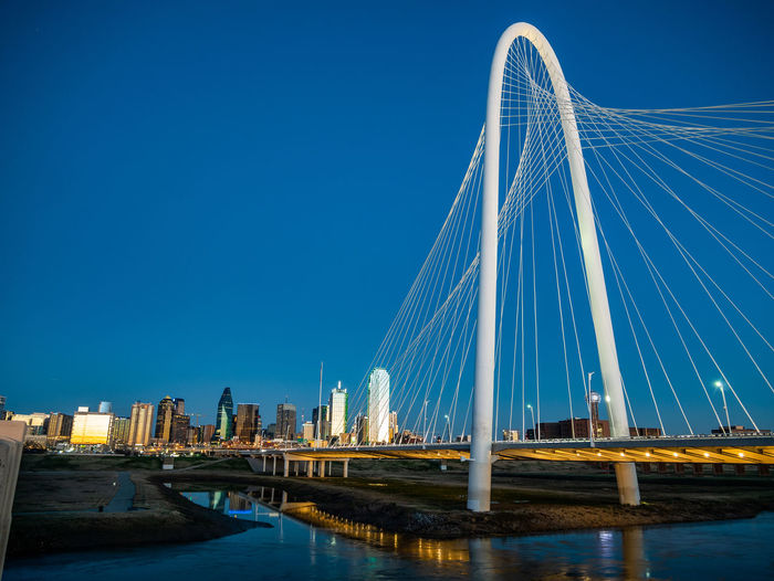 Water Bridge Built Structure Sky Architecture Bridge - Man Made Structure Transportation Connection Blue City Building Exterior River Nature No People Illuminated Clear Sky Cable-stayed Bridge Suspension Bridge Modern Outdoors Office Building Exterior Skyscraper Dallas