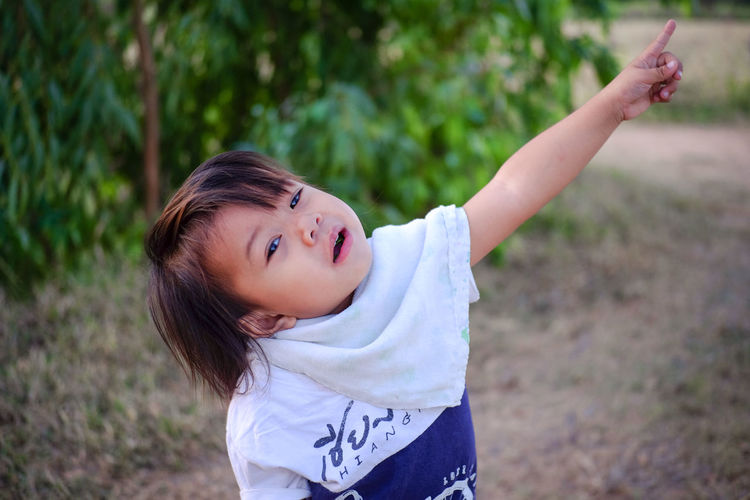 Portrait of cute girl on field