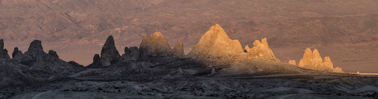 Beautiful sandstone formations in warm evening light California Desert Evening Light Minerals Pinnacles Searles Valley Soft Spires Tourist Attraction  Beauty In Nature Eroded Geological Formation Monument Mountains Nature Outdoors Sandstone Sandstone Formations Towers Travel Destination Trona Pinnacles Tufa Valley Warm Wilderness