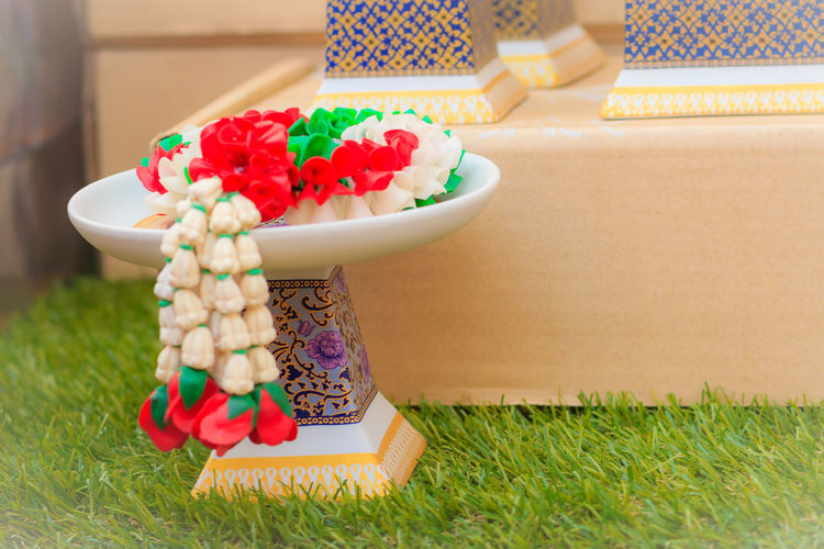 Beautiful Thai's style porcelain tray with pedestal. Ideal for putting the steering sacrifice. Porcelain  Thai's Style Tray Close-up Day Flower Freshness Grass Indoors  Multi Colored No People Pedestal Porcelain Cup Porcelain Tray Sacrifice Sacrifice For Art Steering Steering Sacrifice