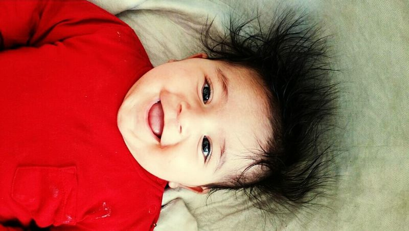Baby Looking At Camera Portrait One Person Children Only Child Headshot People Red Indoors  One Girl Only Girls Childhood Human Body Part Smiling Happiness Real People Close-up Adult Day Eyelash First Eyeem Photo