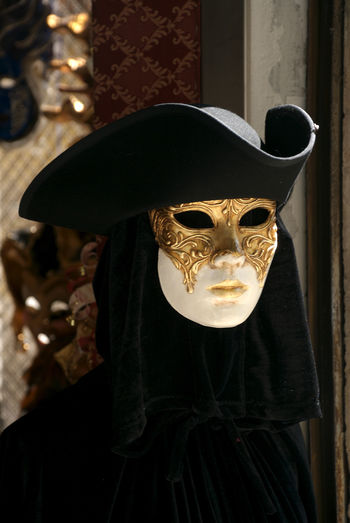 Person wearing venetian mask at carnival