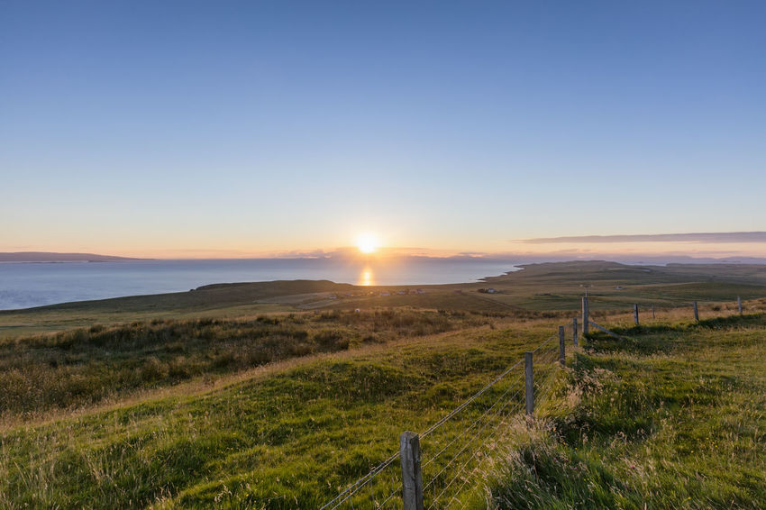 Late evening summer sunset in Totscore on the Isle of Skye in Scotland. A855 Atlantic Coastline Morning Scotland Scottish Skye Totscore Travel Trekking Uig United Kingdom Balgown Hebrides Hike Isle Of Skye Kilvaxter Landscape Linicro Monkstadt Port Tourist Destination Trek Uk Village
