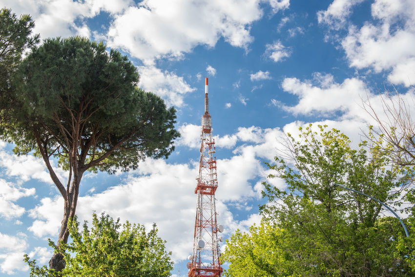 Telecommunication tower against blue sky Antenna Broadcasting Tower Built Structure Cloud - Sky Day Global Communications High Industry Low Angle View No People Outdoors Red Sky Technology Telecommunications Equipment TelecommunicationTower Tower Tree
