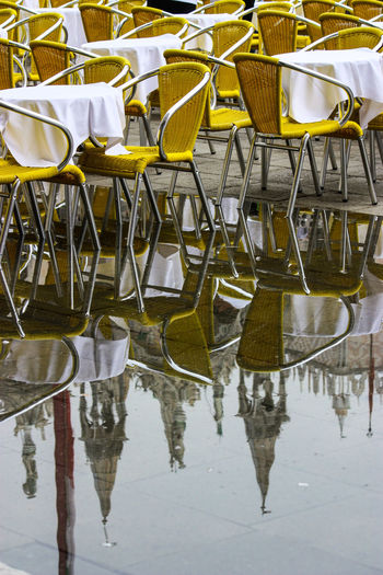 Empty chairs and tables at restaurant
