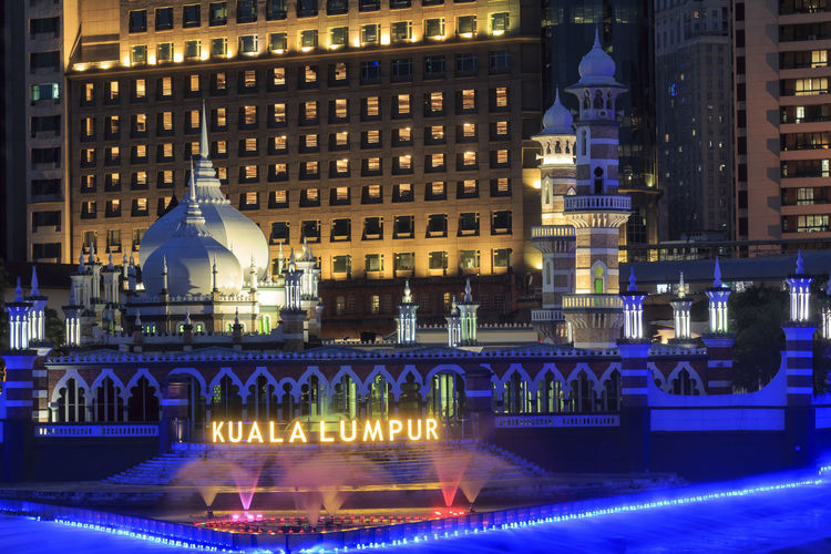 Kuala Lumpur, Malaysia: January 25, 2018: Office buildings and Sultan Abdul Samad Jamek Mosque with water fountain lit at night on the banks of the Klang and Gombak rivers. ASIA Gombak River Klang River Kuala Lumpur Sultan Abdul Samad Jamek Mosque Architecture Building Exterior Built Structure Illuminated Malacca Malacca,malaysia Malaysia Water Water Fountain