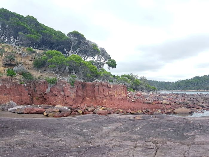 ancient red rocks formed during the Devonian period (360 million years ago) at Ben Boyd National Park near Eden on the NSW South Coast, Australia. Devonian Red Rocks  Regional Town NSW Australia Cloud - Sky No People Outdoors Day Sky Nature Beauty In Nature Geology Eroded Natural Landmark