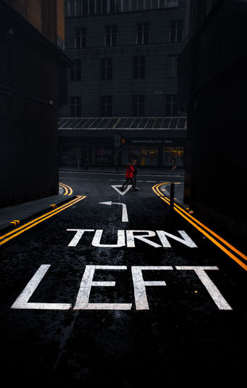Road sign on street in city