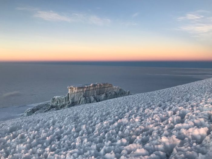 Uhuru peak view , Kilimanjaro Clouds Clouds And Sky At The Peak Mountain Sunset Sky Beauty In Nature Scenics - Nature Tranquil Scene Cloud - Sky Tranquility Nature Cold Temperature Snow No People Outdoors Frozen Winter