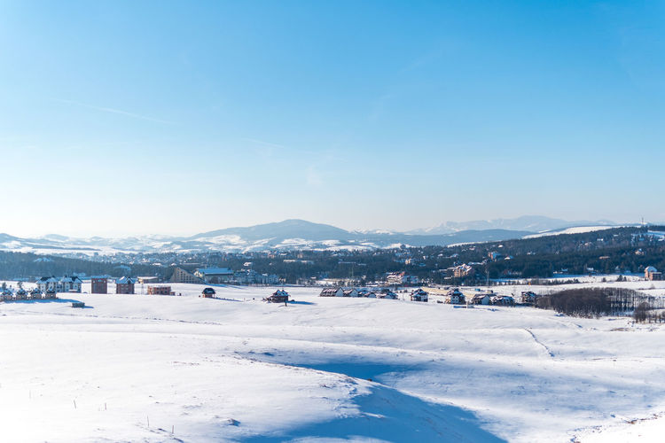 Winter Snow Cold Temperature Mountain Sky Scenics - Nature Beauty In Nature Blue Nature Environment Architecture Day Mountain Range Building Exterior Built Structure Tranquil Scene Landscape Tranquility Building Outdoors No People Snowcapped Mountain Ski Resort