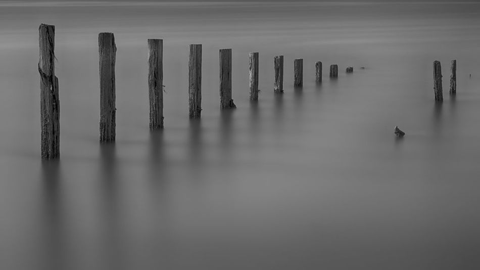 Black & White Calm Breakwater Breakwaters Calm Water Diminishing Perspective Greyscale Horizon In A Row Infinity Longexposure No People Post Reflection Sea Subdued Tranquil Scene Tranquility Water Waterfront Wood - Material Wooden Post First Eyeem Photo