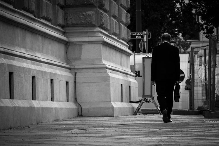 DONE - man going home after work Adult Adults Only Architecture Black And White Done Done Deal Elegant Going Home Going Home From Work Hard Work Head Down Men One Person Real People Rear View Standing Stress Suit Suitcase Walking Work Worker At Work Working Man