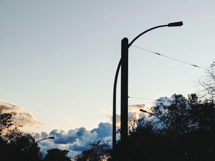 Street light against sky during sunset