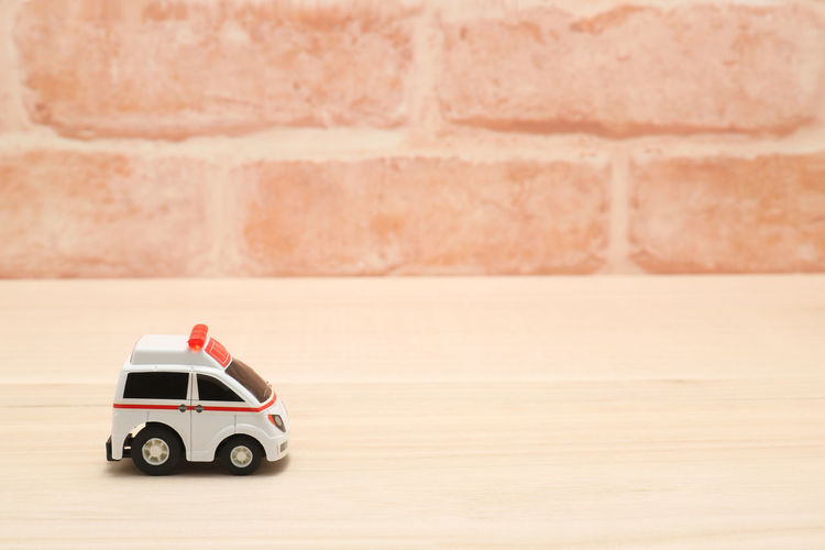 Aid Doctor  Emergency Hospital Paramedic Toy Car Transportation Accident Ambulance Brick Wall Car Copy Space Emergency Services Illness Injury Medical Miniature Rescue Sick Still Life Toy Treatment Urgency Urgent Care Vehicle