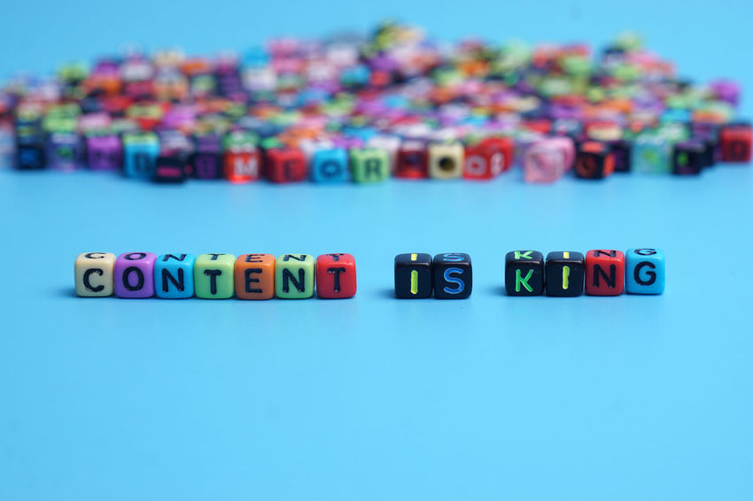 Colorful dice with word CONTENT IS KING on blue background. Conceptual New EyeEm Selects Business Background Leadership Successful Profit Growth Finance Education To Do List Noted Agenda Multi Colored Blue Variation Business Finance And Industry In A Row Display Preschool Block Shape Playroom Cube Shape Alphabet Arrangement Knowledge Colored Pencil For Sale Preschool Student Spelling
