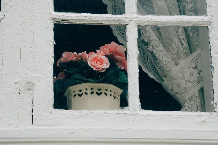 Close-up of rose bouquet on window