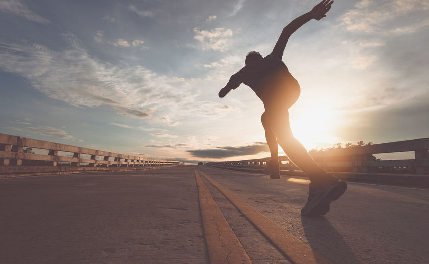 The man with runner on the street be running for exercise. Runners Exercise Running Man Street Healthy Run Strong Sunset Sport Sportsman