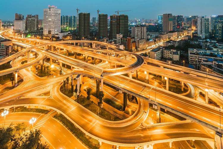 Chengdu, Sichuan Province, China - Oct 28, 2015: Yingmenkou interchange at night. Architecture Building Exterior Built Structure City City Life Engineering High Angle View Illuminated Interchange  Light Trail Long Exposure Modern Motion Night Outdoors Overpass Road Skyscraper Speed Tall - High Tower Transportation Travel Destinations Urban Skyline