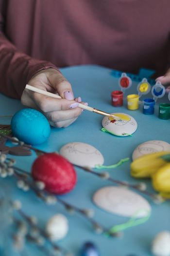 EyeEm Selects Human Body Part Childhood Child Human Hand Art And Craft Multi Colored One Person Body Part Hand Easter Paintbrush Holding Brush Easter Egg Young Paint