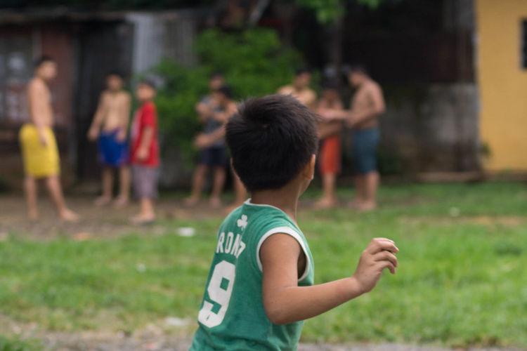 Boy Playing On Field