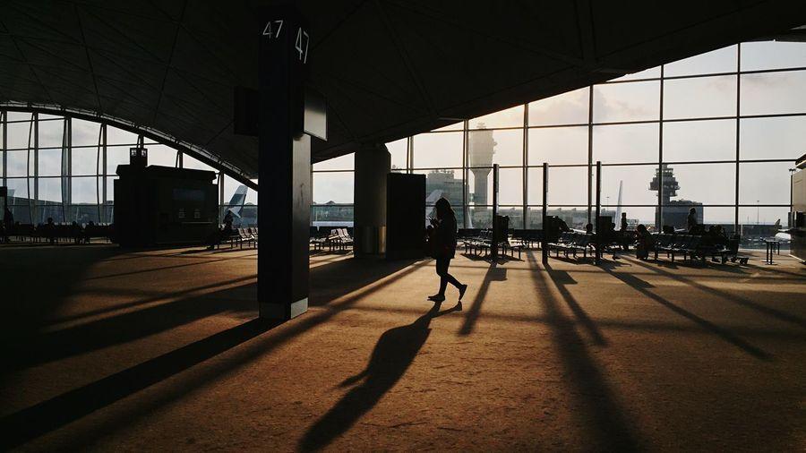 Woman walking at hong kong international airport
