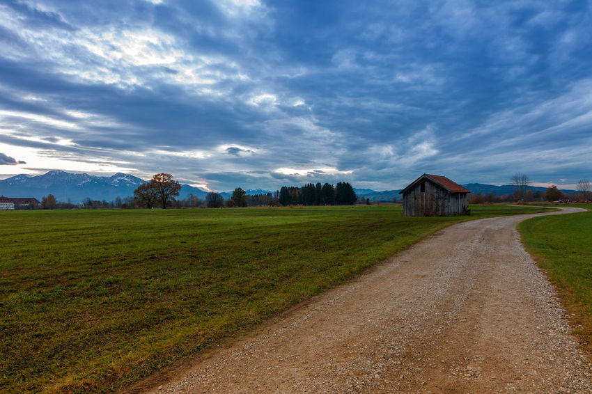 landscape with country road and blue sky Benediktbeuern Cloud - Sky Sky Landscape Grass Environment Architecture Building Exterior Built Structure Field Scenics - Nature Land Building Tranquil Scene Plant Nature Tranquility Road House No People Rural Scene Outdoors