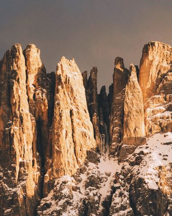 The Great Outdoors - 2017 EyeEm Awards Rock - Object Rock Formation Nature No People Mountain Outdoors Day Beauty In Nature Sky Landscape Italy Cliff Sunset Dramatic Adventure Warm Mountain Range in Dolomites, Italy