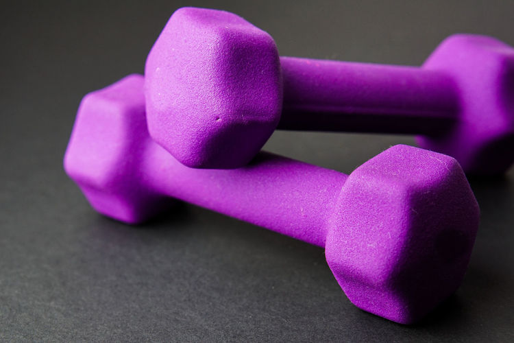 Close-up of purple dumbbells