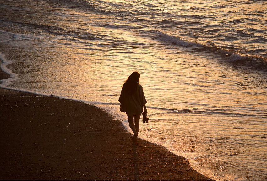Beach Rear View Sea One Person Sunset Outdoors Wave Real People Water Beauty In Nature People Nature Day Adult