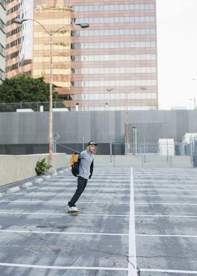 Full length of man on street against building in city