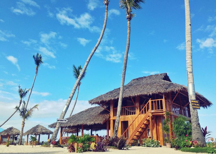 life is a beach. Summer Scenic View Nipahut Beach Sky Cloud - Sky Built Structure Architecture Nature Plant Low Angle View Blue No People Outdoors Sunlight Tree EyeEmNewHere My Best Travel Photo Palm Tree Tropical Climate Thatched Roof
