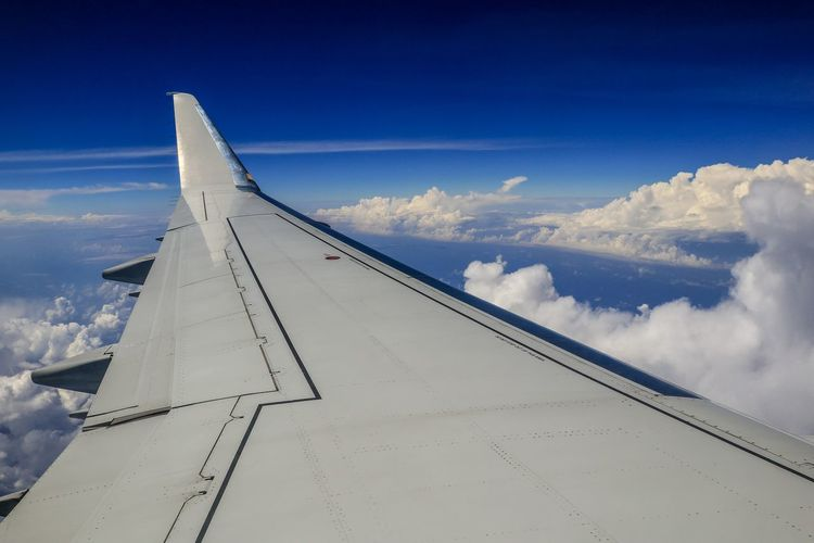 Cloud - Sky Airplane Sky Air Vehicle Aircraft Wing Flying Transportation Mode Of Transportation Nature No People Travel Day Blue Mid-air Journey Outdoors Motion on the move Commercial Airplane White Color Aerospace Industry Above
