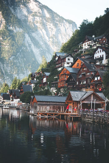beautiful view of Hallstat - Alpine paradise village in the lakeside with houses around the lake Architecture Built Structure Building Exterior Water Building Mountain House Residential District Nature Day Waterfront Reflection No People Lake Tree Outdoors City Town Hallstatt Reflection Architecture Colorful Adventure Alpine Village