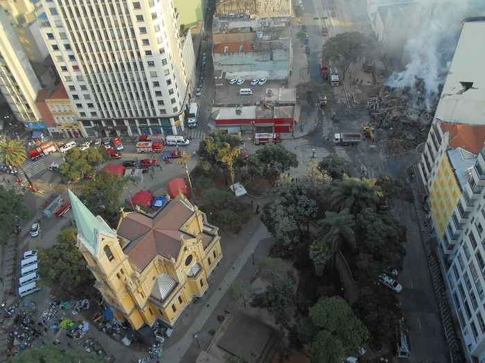 Day 2. Building Collapse: Inner City Calamity in downtown São Paulo at Largo do Paissandú; 3 am May 1, 2018. The abandoned former Federal Police steel and glass skyscraper, which had been invaded by street people, imploded in the early morning hours and the neighboring buildings, including the Lutheran Church on Avenida Rio Branco, were destroyed by fire as well. This photo shows the government infrastructure set-up, principally fire and police support, to respond to the crisis related to the building collapse; photo taken from 23rd floor of my building. Current Events Igreja Nossa Senhora Do Rosário Dos Homens Pretos Largo Do Paissandu May 1, 2018 May 2, 2018 Susan A. Case Sabir Unretouched Photography Building Collapse Building Implosion Burning Building Controlled Chaos Crisis Management Dangerous Situation Downtown São Paulo Firemen At Work Government Support High Angle View Implosion Responsiveness Smoke - Physical Structure Unexpected Event Urban Photography Urban Strife