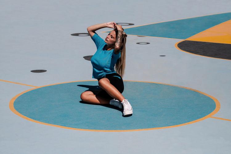 Full length of woman jumping