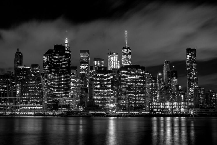 Illuminated new york cityscape against sky at night
